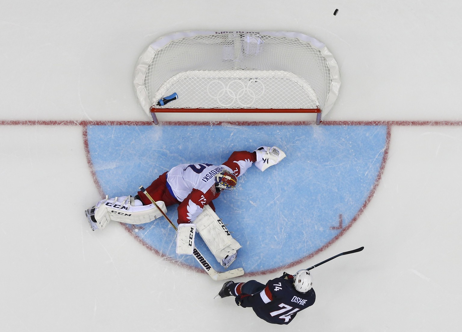 Team USA's T.J. Oshie misses on his shootout attempt on Russia's goalie Sergei Bobrovski during their men's preliminary round ice hockey game at the Sochi 2014 Winter Olympic Games February 15, 2014. REUTERS/Mark Blinch (RUSSIA  - Tags: SPORT ICE HOCKEY OLYMPICS)