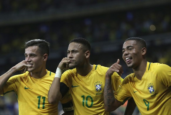 Brazil's Neymar, center, celebrates with teammates Philippe Coutinho, left, and Gabriel Jesus after scoring his side's second goal against Argentina during a 2018 World Cup qualifying soccer match at the Estadio Mineirao in Belo Horizonte, Brazil, Thursday Nov. 10, 2016.(AP Photo/Leo Correa)