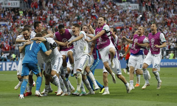 Russian teammates rush to hug and congratulate Russia goalkeeper Igor Akinfeev, left after he makes the a save during a penalty shoot out that send Russia to the quarterfinals during the round of 16 match between Spain and Russia at the 2018 soccer World Cup at the Luzhniki Stadium in Moscow, Russia, Sunday, July 1, 2018. (AP Photo/Manu Fernandez)
