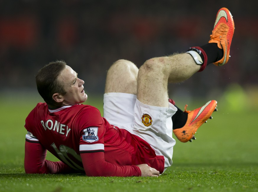 Manchester United's Wayne Rooney lies on the pitch after being hurt during the English Premier League soccer match between Manchester United and Hull City at Old Trafford Stadium, Manchester, England, Saturday Nov. 29, 2014. (AP Photo/Jon Super)