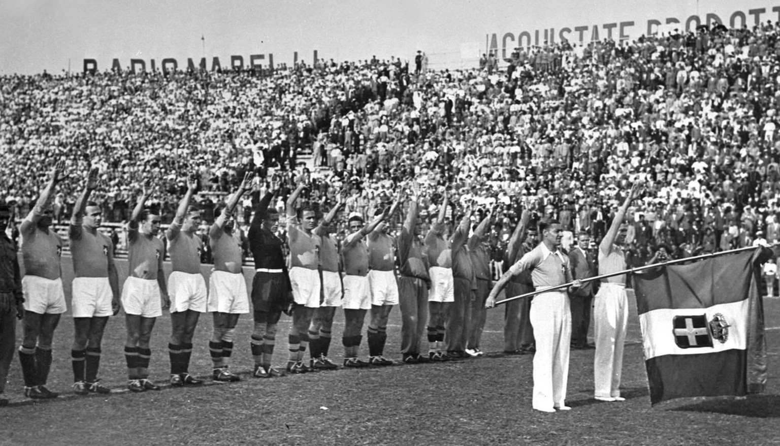 Italian soccer team performs the fascist salute before the kick off of the World Cup Final. Italy defeated Czechoslovakia 2-1 after extra time to win the Rimet Cup on June 10, 1934, at the Fascist National Party Stadium in Rome, Italy. (AP Photo)