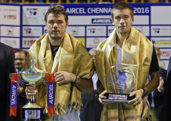 Switzerland's Stan Wawrinka, left and Croatia's Borna Coric pose with their trophies after the Chennai Open tennis event in Chennai, India, Sunday, Jan.10, 2016.Wawrinka won his fourth title at the Chennai Open on Sunday with a 6-3, 7-5 win over 19-year-old Coric, the youngest player in the world's top 50 at No. 44. (AP Photo/Arun Sankar K)