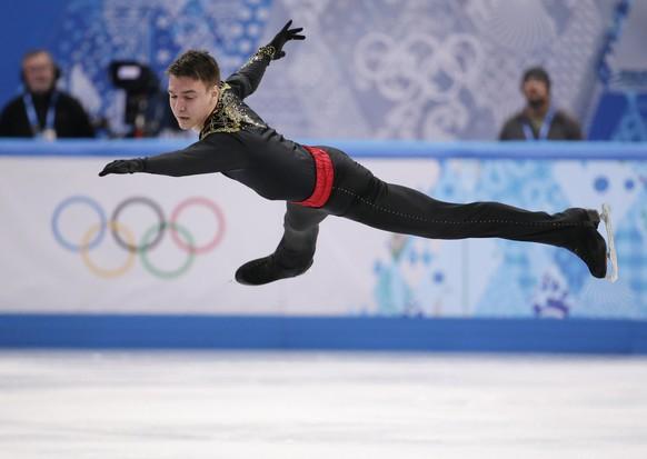 Viktor Romanenkov of Estonia competes in the men's free skate figure skating final at the Iceberg Skating Palace during the 2014 Winter Olympics, Friday, Feb. 14, 2014, in Sochi, Russia. (AP Photo/Bernat Armangue)