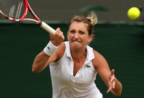 Switzerland's Timea Bacsinszky returns to Russia's Maria Sharapova during their women's singles second round match on day four of the 2014 Wimbledon Championships at The All England Tennis Club in Wimbledon, southwest London, on June 26, 2014. AFP PHOTO / ANDREW YATES  - RESTRICTED TO EDITORIAL USE