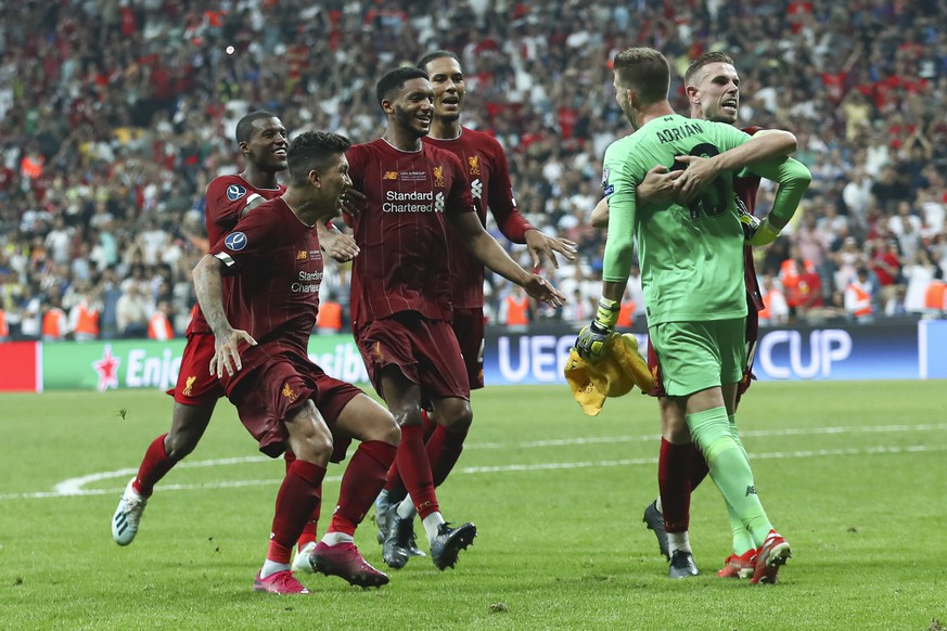 epa07773876 Liverpool's goalkeeper Adrian (2-R) celebrates with team mates after winning the UEFA Super Cup match between Liverpool FC and Chelsea FC in Istanbul, Turkey, 14 August 2019.  EPA/SEDAT SUNA