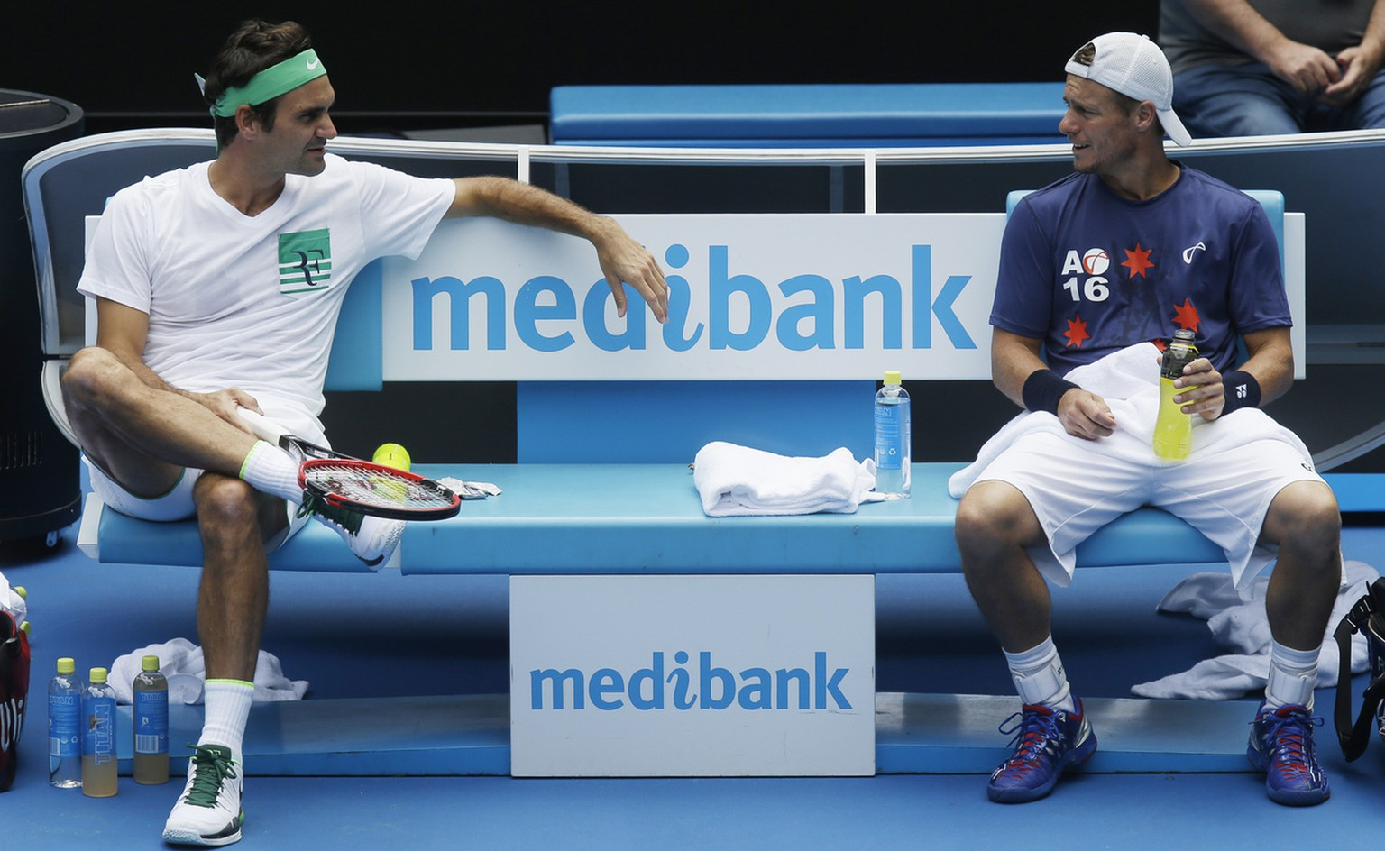 Switzerland's Roger Federer, left, talks with Australia's Lleyton Hewitt during a practice session on Rod Laver Arena ahead of the Australian Open tennis championships in Melbourne, Australia, Friday, Jan. 15, 2016.(AP Photo/Mark Baker)