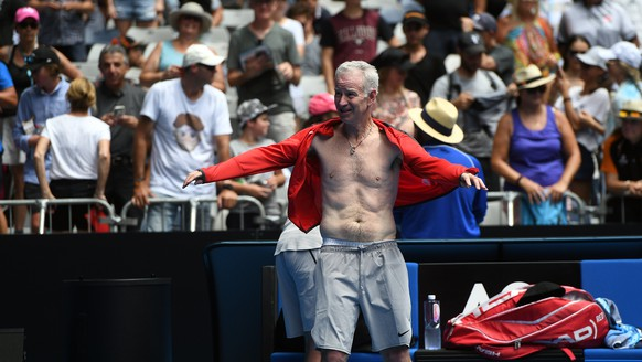 epa06459237 John McEnroe of the USA during a break in play with Patrick McEnroe in their legends doubles match against Mansour Bahrami and Fabrice Santoro of France on day seven at the Australian Open tennis tournament, in Melbourne, Victoria, Australia, 21 January 2018.  EPA/JULIAN SMITH  AUSTRALIA AND NEW ZEALAND OUT