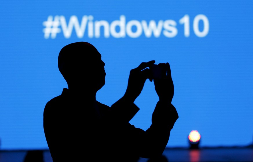 A Microsoft delegate takes a picture during the launch of the Windows 10 operating system in Kenya's capital Nairobi, July 29, 2015. Microsoft Corp's launch of its first new operating system in almost three years, designed to work across laptops, desktop and smartphones, won mostly positive reviews for its user-friendly and feature-packed interface. REUTERS/Thomas Mukoya
