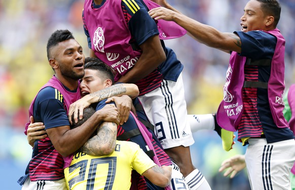 epa06820905 Juan Quintero of Colombia (down) reacts with teammates after scoring the 1-1 during the FIFA World Cup 2018 group H preliminary round soccer match between Colombia and Japan in Saransk, Russia, 19 June 2018.  (RESTRICTIONS APPLY: Editorial Use Only, not used in association with any commercial entity - Images must not be used in any form of alert service or push service of any kind including via mobile alert services, downloads to mobile devices or MMS messaging - Images must appear as still images and must not emulate match action video footage - No alteration is made to, and no text or image is superimposed over, any published image which: (a) intentionally obscures or removes a sponsor identification image; or (b) adds or overlays the commercial identification of any third party which is not officially associated with the FIFA World Cup)  EPA/RUNGROJ YONGRIT   EDITORIAL USE ONLY  EDITORIAL USE ONLY
