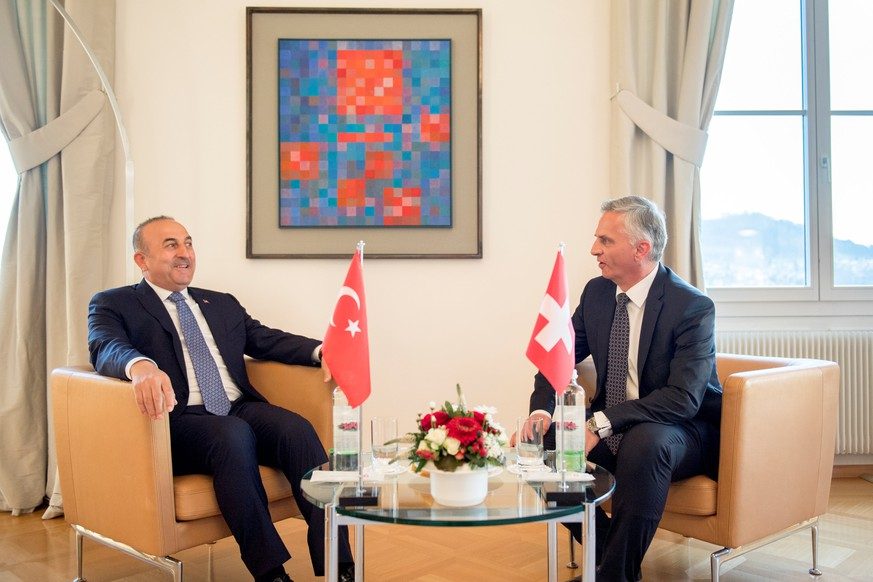 Turkey's Foreign Minister Mevlut Cavusoglu (L) and Switzerland's Federal Councillor Didier Burkhalter talk during Cavusoglu's visit to Switzerland follwing a weeks-long dispute between Turkey and several other European nations over campaigning by Turkish politicians, in Bern, Switzerland. March 23, 2017. REUTERS/Anthony Anex/Pool