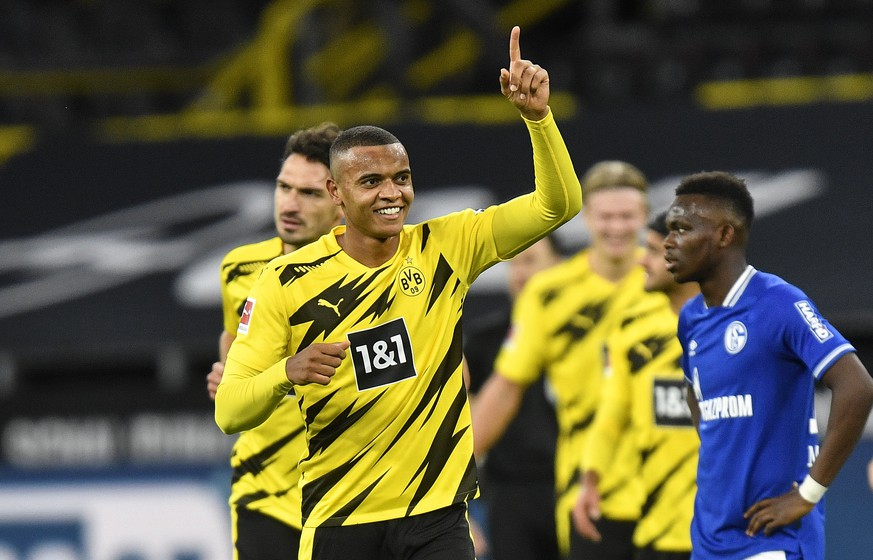 Dortmund's Manuel Akanji celebrates after he scored the opening goal during the German Bundesliga soccer match between Borussia Dortmund and FC Schalke 04 in Dortmund, Germany, Saturday, Oct. 24, 2020. (AP Photo/Martin Meissner, Pool)