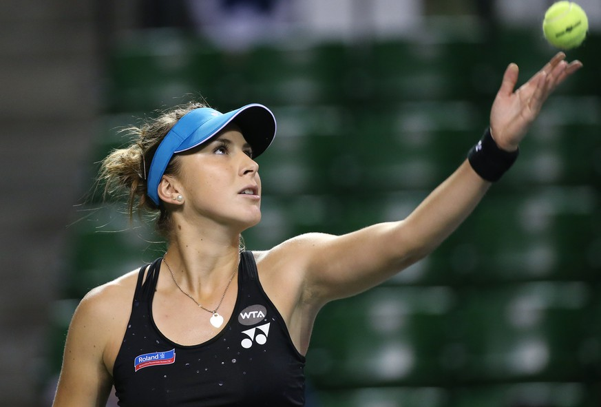 Belinda Bencic of Switzerland tosses a ball to serve against Garbine Muguruza of Spain during a quarterfinal match at the Pan Pacific Open women's tennis tournament in Tokyo, Friday, Sept. 25, 2015. (AP Photo/Eugene Hoshiko)
