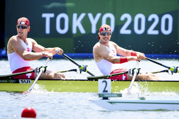 Swiss rowers Barnabe Delarze and Roman Roeoesli compete in the men's rowing double sculls heat at the 2020 Tokyo Summer Olympics in Tokyo, Japan, on Friday, July 23, 2021. (KEYSTONE/Laurent Gillieron)