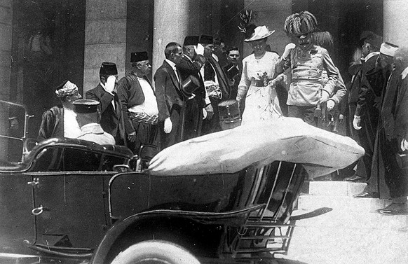 ONE OF ONE HUNDRED PHOTOS WORLD WAR ONE CENTENARY TIMELINE FILE - In this June 28, 1914 file photo, the Archduke of Austria Franz Ferdinand, center right, and his wife Sophie, center left, walk to their a car in Sarajevo. This photo was taken minutes before the assassination of the Archduke and his wife, an event which set off a chain reaction of events which would eventually lead to World War One. (AP Photo, File)