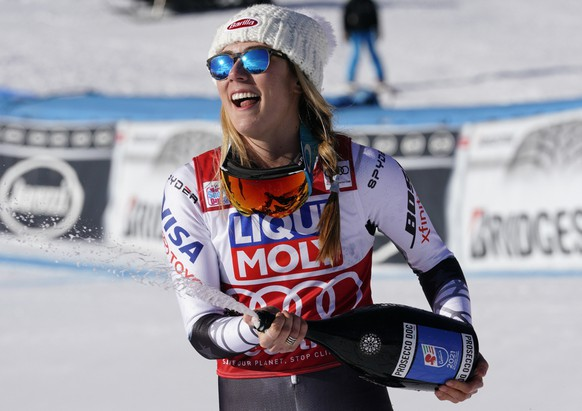 "FILE - In this Sunday, Jan. 20, 2019 filer, United States' Mikaela Shiffrin sprays sparkling wine as she celebrates after winning an alpine ski, women's World Cup super-G in Cortina D'Ampezzo, Italy. It seemed like destiny played a role on Sunday when Mikaela Shiffrin won what could very well turn out to be Lindsey Vonn's last race. Vonn broke down emotionally after she failed to finish a World Cup super-G on knees so worn down that she describes them as ""bone on bone."" Shiffrin then came down nine racers later and won her first speed race at the premier stop on the women's circuit. (AP Photo/Giovanni Auletta, File)"