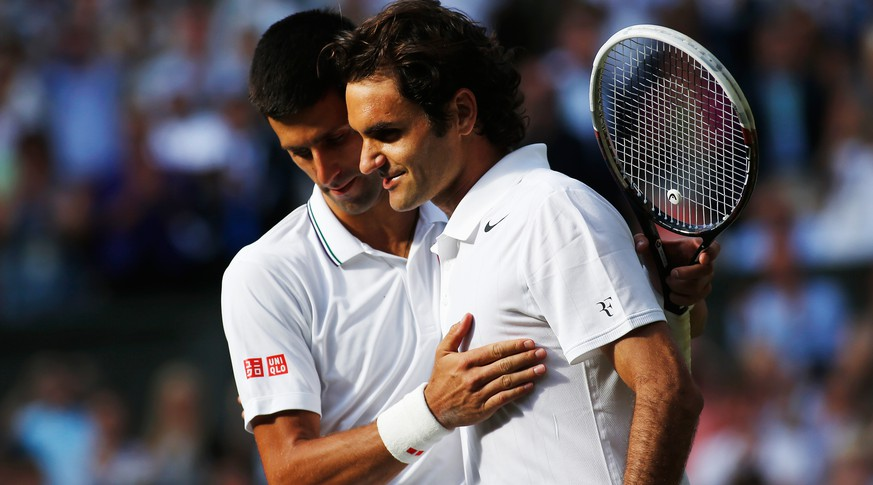 LONDON, ENGLAND - JULY 06:  Novak Djokovic of Serbia shakes hands with Roger Federer of Switzerland after their Gentlemen's Singles Final match on day thirteen of the Wimbledon Lawn Tennis Championships at the All England Lawn Tennis and Croquet Club on July 6, 2014 in London, England.  (Photo by Pool/Getty Images)