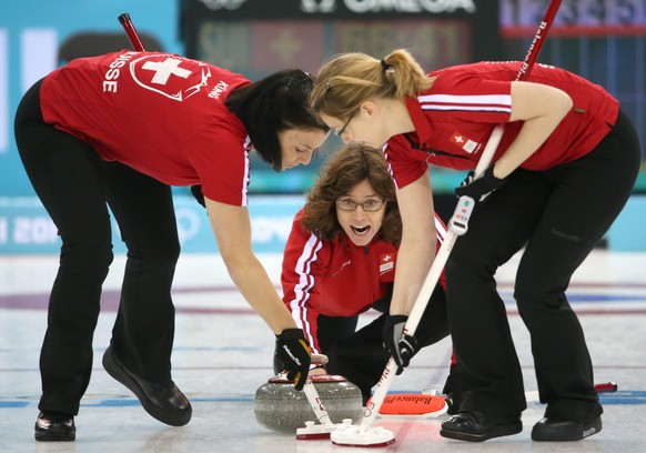 epa04066190 Mirjam Ott (C) of Switzerland in action, as Carmen Kueng (L) and  Janine Greiner (R) sweep during the Round Robin match between  Switzerland  and USA of the WomenÔs Curling Competition at the Sochi 2014 Olympic Games, Sochi, Russia, 10 February 2014.  EPA/TATYANA ZENKOVICH