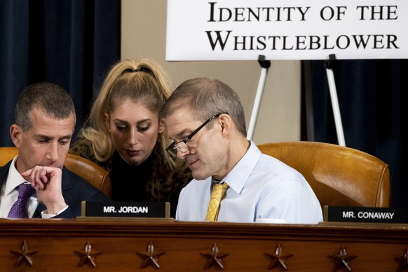 Republican staff attorney Steve Castor, left, and Rep. Jim Jordan, R-Ohio, right, huddle with a staff member as U.S. Ambassador to the European Union Gordon Sondland testifies before the House Intelligence Committee on Capitol Hill in Washington, Wednesday, Nov. 20, 2019, during a public impeachment hearing of President Donald Trump's efforts to tie U.S. aid for Ukraine to investigations of his political opponents.  (Anna Moneymaker/Pool Photo via AP) Jim Jordan,Steve Castor