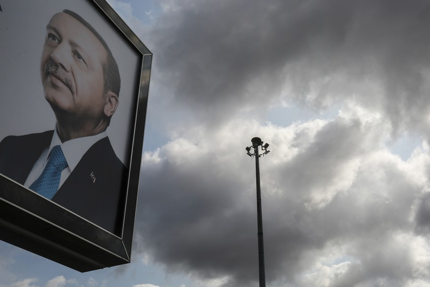 A day after the elections, a billboard with the image of Turkey's president Recep Tayyip Erdogan, is displayed, in Istanbul, Monday, June 25, 2018. Turkey's national electoral board has declared Erdogan the winner of the country's presidential election with an absolute majority of valid votes. (AP Photo/Emrah Gurel)