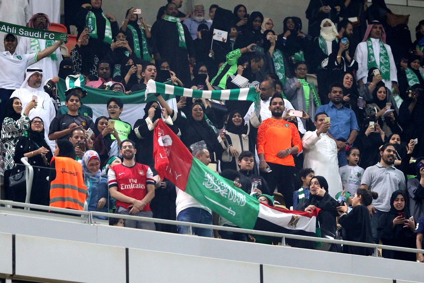 epa06434153 Saudi families cheer at the King Abdullah Sports City known as 'a radiant jewel' to attend the Saudi Football League soccer match Al Ahly and Al-Batin in Jeddah, Saudi Arabia, 12 January 2018. Saudi women for the first time are allowed to enter a sports stadium to watch a soccer match. They will be segregated from the male-only crowd with designated seating in the so-called 'family section'.  EPA/STR