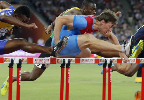 Russia's Sergey Shubenkov, right, leads Barbados' Shane Brathwaite, centre, and United States' Aleec Harris in a men's 110m hurdles semifinal at the World Athletics Championships at the Bird's Nest stadium in Beijing, Thursday, Aug. 27, 2015. (AP Photo/Ng Han Guan)