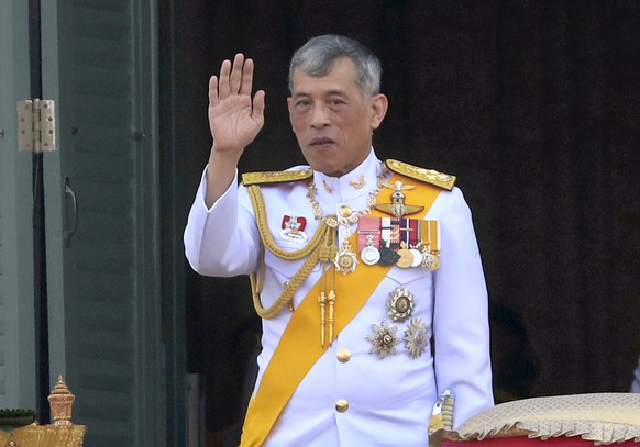 Thailand's King Maha Vajiralongkorn greets an audience from the balcony of Suddhaisavarya Prasad Hall in the Grand Palace during the coronation ceremony Monday, May 6, 2019, in Bangkok, Thailand. Vajiralongkorn was officially crowned amid the splendor of the country's Grand Palace, taking the central role in an elaborate centuries-old royal ceremony that was last held almost seven decades ago. (AP Photo/Sakchai Lalit)