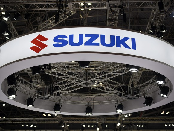 epa05010198 The Suzuki Motor logo at the 44th Tokyo Motor Show 2015 in Tokyo, Japan, 04 November 2015. Suzuki Motor revised up its profit forecast for the current financial year by around 13 percent amid robust sales in India. For the July-to-September period, Suzuki said its net profit nearly tripled from the same period last year to 391 million USD, while posting an operating profit up 16 percent from a year earlier.  EPA/FRANCK ROBICHON