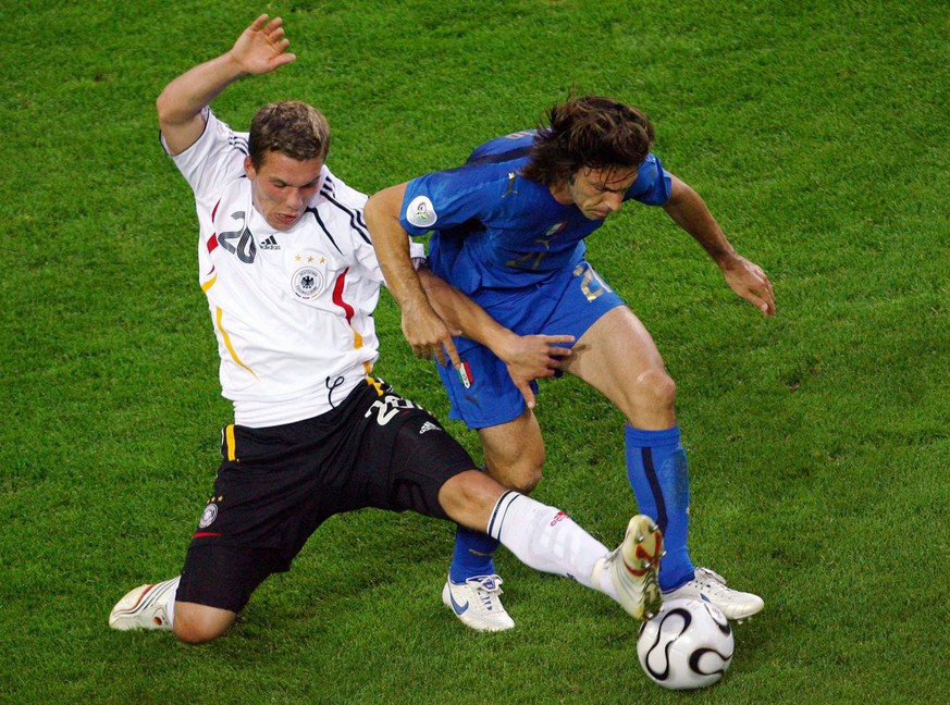 Lukas Podolski (L) from Germany vies with Andrea Pirlo from Italy during the semi final of the 2006 FIFA World Cup between Germany and Italy in Dortmund, Germany, Tuesday, 04 July 2006. EPA/FELIX HEYDER +++ Mobile Services OUT +++ Please refer to FIFA's terms and conditions