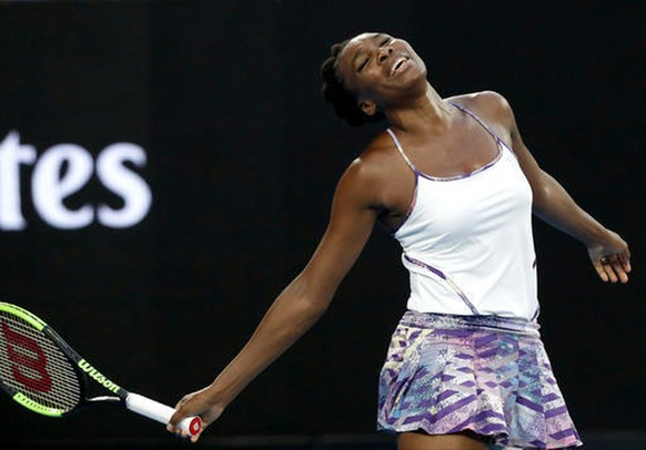 FILE - In this Saturday, Jan. 28, 2017, file photo, United States' Venus Williams reacts after missing a shot against sister Serena during the women's singles final at the Australian Open tennis championships in Melbourne, Australia. Williams will show off her spring tennis clothing line at Madison Square Garden. The EleVen by Venus collection will be worn by ball girls and ushers at the BNP Paribas Showdown on Monday, March 6. Williams will also play French Open champion Garbine Muguruza in the exhibition. (AP Photo/Kin Cheung, File)