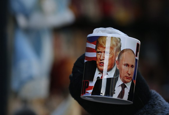 epa05734373 A mug depicting Donald Trump and Russian President Vladimir Putin on sale several hours before Donald J. Trump is sworn in as the 45th President of the United States, at a souvenir street shop in St. Petersburg, Russia, 20 January 2017. Trump won the 08 November 2016 election to become the next US President.  EPA/ANATOLY MALTSEV