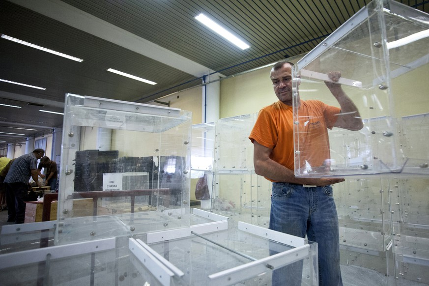 A municipal worker arranges ballot boxes to be used for a referendum announced by the Greek government for July5 at the northern city of Thessaloniki June 30, 2015. The head of the European Commission made a last-minute offer to try to persuade Greek Prime Minister Alexis Tsipras to accept a bailout deal he has rejected before a referendum on Sunday which EU partners say will be a choice of whether to stay in the euro. REUTERS/Alexandros Avramidis