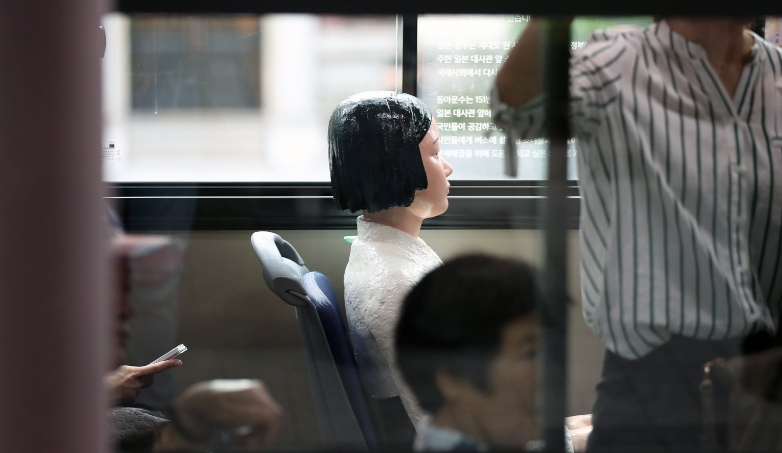 epa06143791 A 'comfort woman' statue is installed on a No. 151 line Seoul city bus in Seoul, South Korea, 14 August 2017, during the International Memorial Day for Comfort Women. Donga Bus Co. said it will install five such statues on its buses from 14 August through 30 September in order to provide children with a chance to learn the history of Japan's wartime occupation and atrocities. Comfort women are a euphemistic expression for Korean women who were forcibly taken to Japanese front-line military brothels during World War II.  EPA/YONHAP SOUTH KOREA OUT