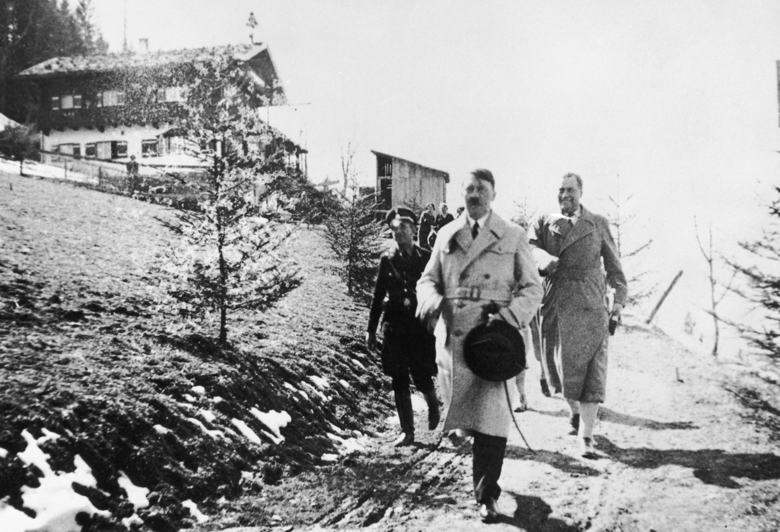 Adolf Hitler outside the Berghof, his country retreat in the Obersalzberg of the Bavarian Alps, with Friedrich Bruckner in the background, circa 1944. (Photo by Popperfoto/Getty Images)