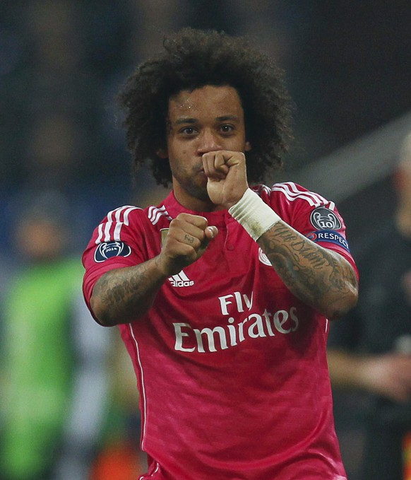 Real Madrid's Marcelo celebrates after scoring a goal against Schalke 04 during their Champions League Round of 16 first leg soccer match in Gelsenkirchen, February 18, 2015.    REUTERS/Ina Fassbender (GERMANY  - Tags: SPORT SOCCER TPX IMAGES OF THE DAY)