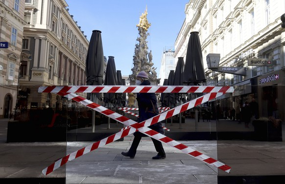 Closed areas of coffee houses pictured in downtown in Vienna, Austria, Monday, Feb. 15, 2021. The Austrian government has moved to restrict freedom of movement for people, in an effort to slow the onset of the COVID-19 disease and the spread of the coronavirus. (AP Photo/Ronald Zak)