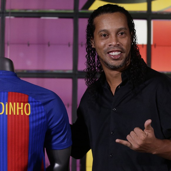 FC Barcelona former player Ronaldinho gestures during his official presentation as new FC Barcelona ambassador at the Camp Nou stadium in Barcelona, Spain, Friday, Feb. 3, 2017. Ronaldinho will be named its new ambassador, representing the club at various institutional events and helping