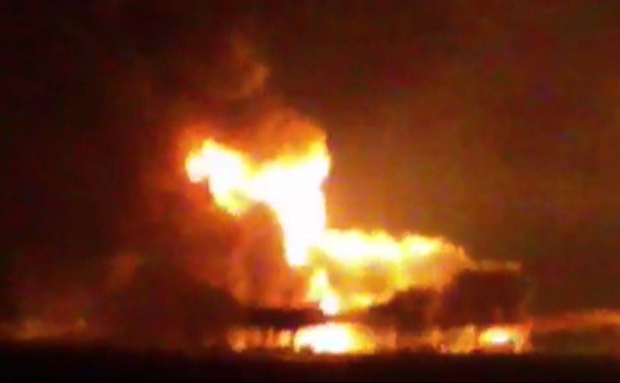 This frame grab of a video from the news station Noticias Ciudad del Carmen shows a fire burning at an oil platform in the Gulf of Mexico along the Mexican coast before sunrise on Wednesday, April 1, 2015. The fire broke out overnight at the Abkatun Permanente platform, located in the Campeche Sound, near the coast of the Mexican states of Campeche and Tabasco. (AP Photo/Noticias Ciudad del Carmen via APTN)