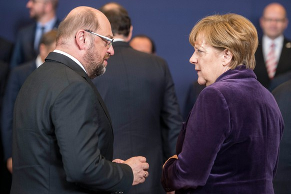 epa05746965 (FILE) - The file picture dated 17 December 2015 shows then President of the European Parliament Martin Schulz (L) and German Chancellor Angela Merkel (R) at the start of an EU Summit in Brussels, Belgium. According to media reports on 24 January 2017, Martin Schulz has been suggested to run as the Social Democrats candidate for German chancellor instead of the Leader of the Social Democratic Party of Germany (SPD) and Vice Chancellor Sigmar Gabriel. Schulz is meant to challenge conservative Chancellor Angela Merkel in the September 2017 election.  EPA/STEPHANIE LECOCQ