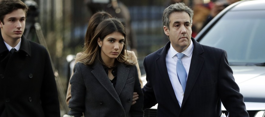 ADDS DAUGHTER AND SON'S NAMES - Michael Cohen, right, President Donald Trump's former lawyer, arrives at federal court with his daughter, Samantha Cohen, center, and son, Jake Cohen, for his sentencing for dodging taxes, lying to Congress and violating campaign finance laws in New York on Wednesday, Dec. 12, 2018. (AP Photo/Julio Cortez)