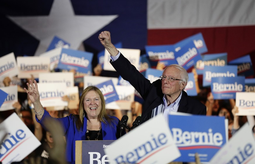 Democratic presidential candidate Sen. Bernie Sanders, I-Vt., right, with his wife Jane, raises his hand as he speaks during a campaign event in San Antonio, Saturday, Feb. 22, 2020. (AP Photo/Eric Gay) Bernie Sanders,Jane Sanders