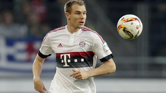In this Dec. 19, 2015 picture Bayern's Holger Badstuber plays the ball during the German Bundesliga soccer match between Hannover 96 and FC Bayern Munich in Hannover, Germany.  Bayern Munich and Germany defender Holger Badstuber is all but certain to miss the rest of the season with a fractured ankle. The 26-year-old central defender was injured in training Saturday feb. 13, 2016, Bayern said. The club said he had already undergone an operation and will be out for three months, jeopardizing his chances of playing in the European Championship. The month-long Euro 2016 starts June 10 in France.  (AP Photo/Michael Sohn)