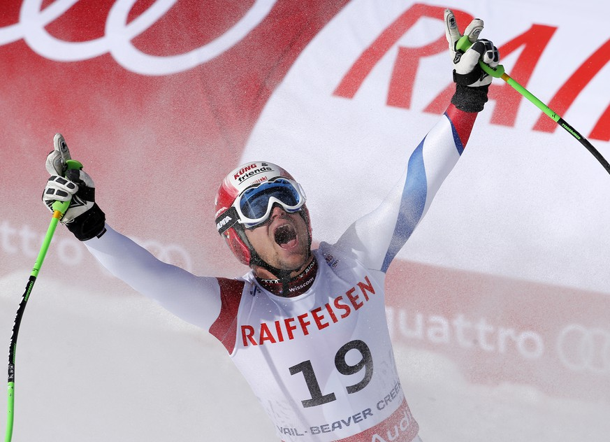 Switzerland's Patrick Kueng reacts after completing his run during the men's downhill competition at the alpine skiing world championships on Saturday, Feb. 7, 2015, in Beaver Creek, Colo. (AP Photo/Marco Trovati)