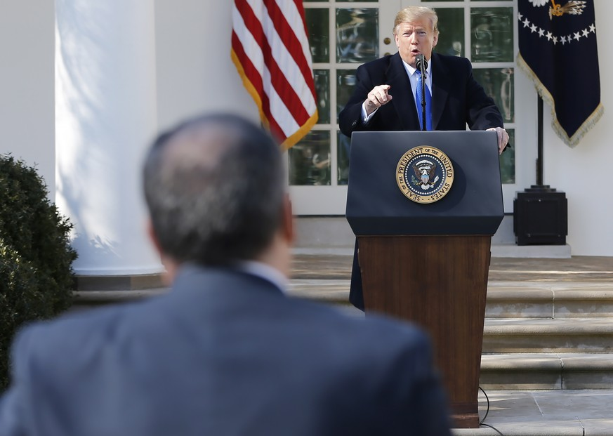 epa07372971 US President Donald J. Trump gets into an exchange with reporter Brian J. Karem (L) as Trump answers questions after speaking about a 328 billion USD (290.7 billion euro) spending bill to prevent another government shutdown at the Rose Garden of the White House in Washington, DC, USA, 15 February 2019. President Trump also declared a national emergency to attempt to build his long-promised border wall. Democratic lawmakers have already announced they will challenge that declaration.  EPA/ERIK S. LESSER