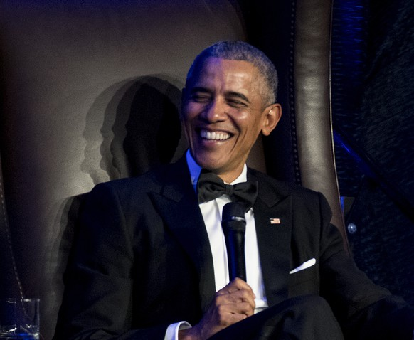 Former President Barack Obama speaks with Jon Meacham as he takes the stage during the 25th anniversary gala celebration for Rice University's Baker Institute for Public Policy on Tuesday, Nov. 27, 2018, in Houston. (Brett Coomer/Houston Chronicle via AP)