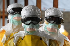 Health care workers, wearing protective suits, leave a high-risk area at the French NGO Medecins Sans Frontieres (Doctors without borders) Elwa hospital on August 30, 2014 in Monrovia. Liberia has been hardest-hit by the Ebola virus raging through west Africa, with 624 deaths and 1,082 cases since the start of the year. AFP PHOTO / DOMINIQUE FAGET