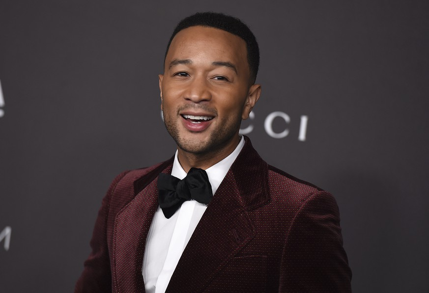 FILE - This Nov. 2, 2019 file photo shows John Legend at the 2019 LACMA Art and Film Gala in Los Angeles. People magazine has named Legend as the sexiest man alive in their special double issue on newsstands nationwide on Nov. 15. (Photo by Jordan Strauss/Invision/AP, File) John Legend