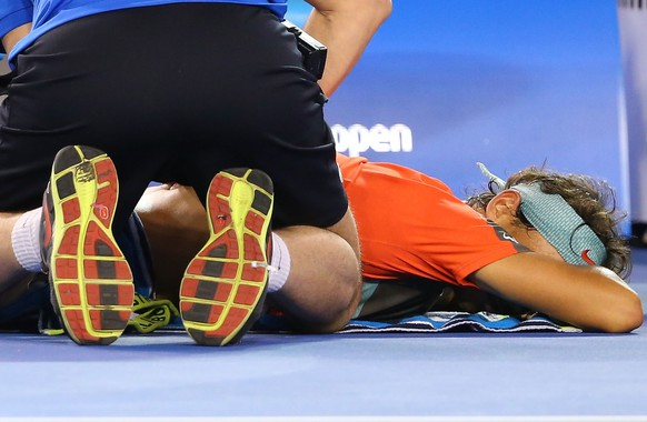 MELBOURNE, AUSTRALIA - JANUARY 26:  Rafael Nadal of Spain receives a back massage in his men's final match against Stanislas Wawrinka of Switzerland during day 14 of the 2014 Australian Open at Melbourne Park on January 26, 2014 in Melbourne, Australia.  (Photo by Quinn Rooney/Getty Images)