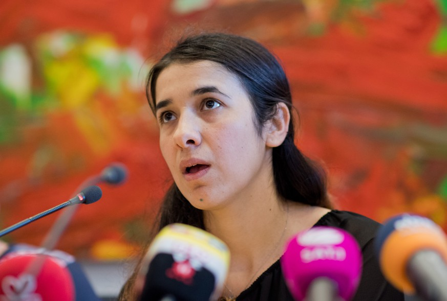 epa05338938 Human rights activist Nadia Murad Bansee Taha speaks at the state parliament in Hanover, Germany, 31 May 2016. The human right activist spoke about her time as a prisoner of the Islamic State during a fraction meeting of SPD party. Nadia Murad Basee Taha is nominated for the Nobel Peace Prize.  EPA/JULIAN STRATENSCHULTE
