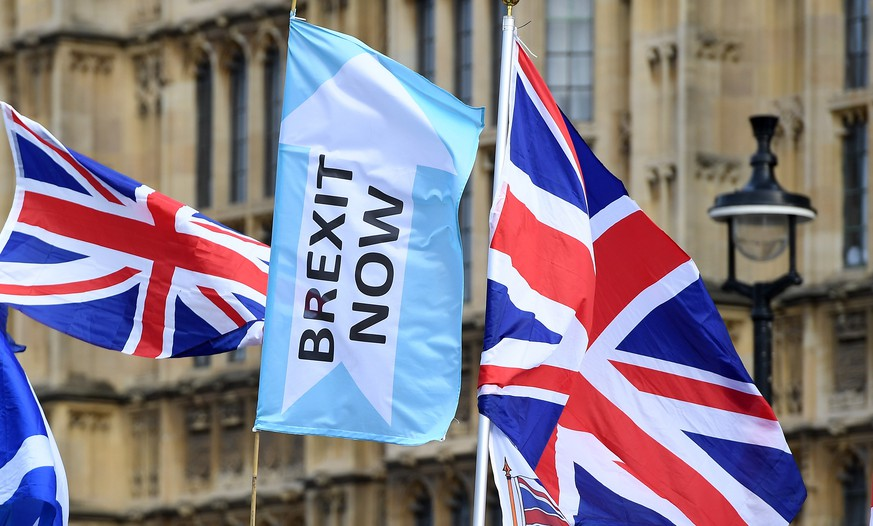epa07956205 A Brexit Now flags flys outside parliament in London, Britain, 28 October 2019. British Prime Minister Boris Johnson is awaiting today's vote at parliament on his general election motion.  EPA/ANDY RAIN