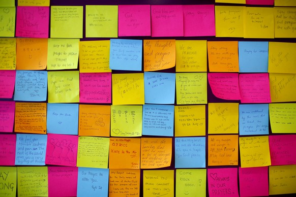 Messages for passengers on board the missing AirAsia flight 8501 are placed on a board at Changi International Airport, Tuesday, Dec. 30, 2014 in Singapore. Searchers combing the Java Sea to find and recover debris and bodies from the AirAsia jet that crashed there have the advantage of working in much shallower waters than those found in the open ocean, but also face challenges that include monsoons, murkiness and trash. (AP Photo/Wong Maye-E)